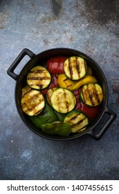 Grilled vegetables in iron pot