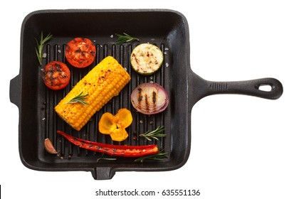 Grilled vegetables on grill pan. Isolated on white background. The view from the top.