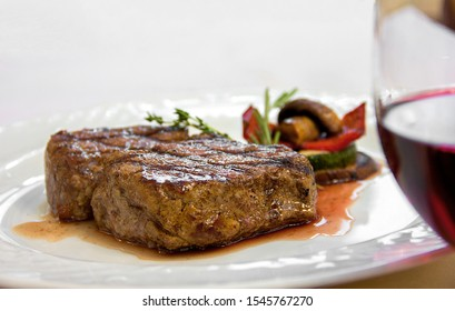 grilled vegetables steak with sauce on a white plate. restaurant serving, tasty and healthy food