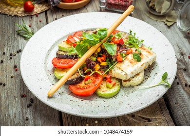 grilled vegetables, grilled suluguni cheese, on a wooden background