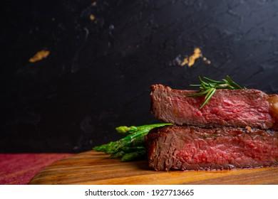 grilled venison fillet on wooden table close up