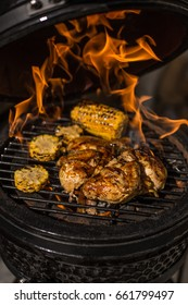 Grilled whole chicken with corn on hot flaming grill. Barbecue. Restaurant