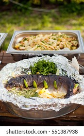 grilled whole salmon fish and potato