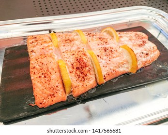 Grilled whole salmon side fillet with lemon, top view