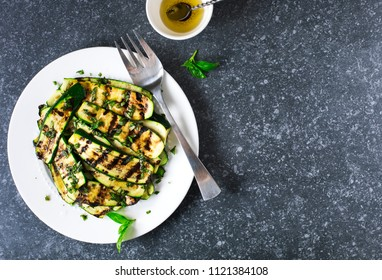 Grilled zucchini with basil and olive oil, top view