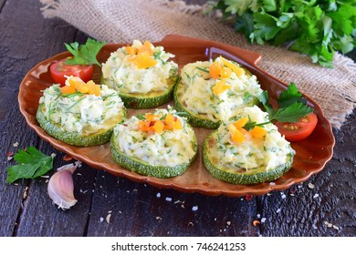 Grilled zucchini with cheese and garlic topping