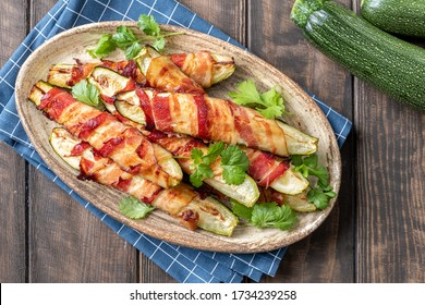 Grilled zucchini fries wrapped in a bacon