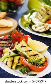 Grilled zucchini and other vegetables served on a plate