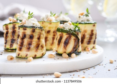 Grilled zucchini rolls stuffed with cream cheese, pickles, capers and herbs