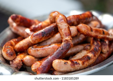 Grilleg pork sausages on the plate - close up view