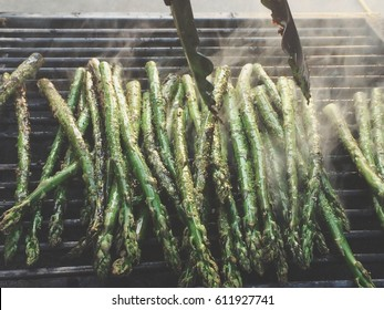 Grilling asparagus on a summer day