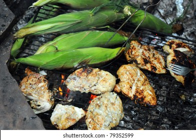 Grilling Corn and chicken Outside on the grill