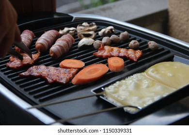 grilling meat with raclette