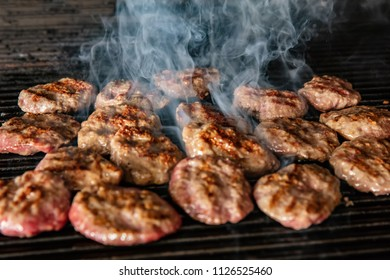 Grilling meatballs on the grill. Turkish cuisine.