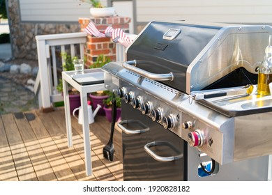 Grilling outdoor on a gas burning grill on the backyard patio.