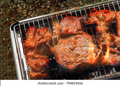 Grilling pork steaks on barbecue grill. Selective focus