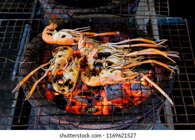 Grilling river prawn with charcoal stove, famous Thai food.