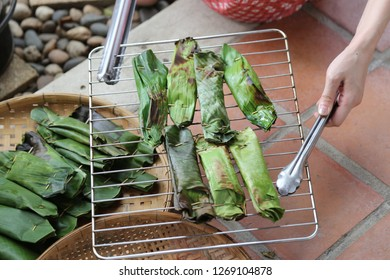 grilling sticky rice in banana leaf