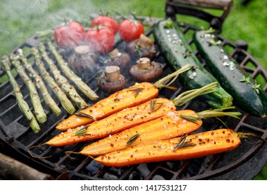 Grilling vegetables with the addition of spices and herbs on the grill plate outdoors. Vegan grilled food