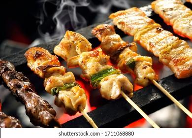 Grilling yakitori (Japanese style skewered chicken)