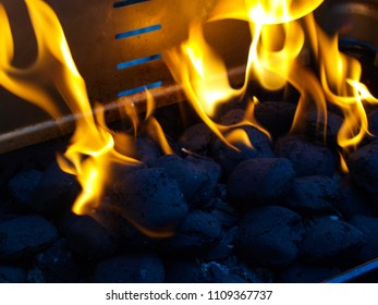 Grills racket with burning charcoal.