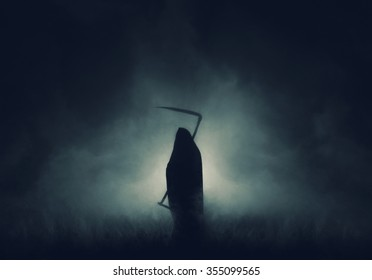 Grim reaper, the death itself, scary horror shot of Grim Reaper in fog holding scythe.