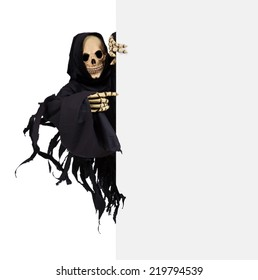 Grim Reaper pointing the finger at a blank panel, isolated on white background.  Skeleton in tattered black suit pointing at a empty billboard