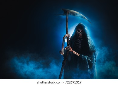 grim reaper with scythe on a smoky background / high contrast image