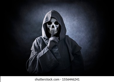 Grim reaper showing hush sign
