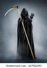 Grim Reaper welcomes you. Photo of silhouette grim reaper showing greeting gesture. Death