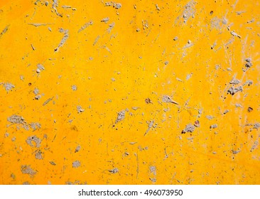 grime of cement on rusty yellow metal plate background
