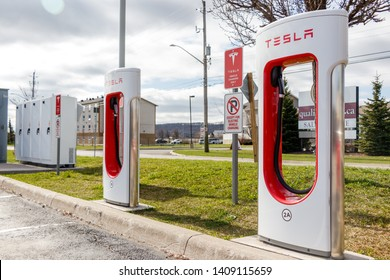 GRIMSBY, CANADA - April 24th, 2019: Two Tesla Supercharger Stalls in at Tesla's Grimsby location.