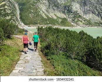 Grimselpass, Switzerland - August 16, 2016: Hikers in the region of Grimselpass