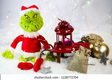 grinch with lantern and white background