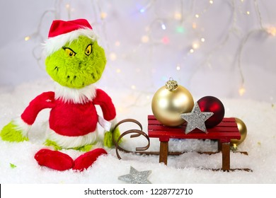grinch with sled and Christmas tree balls