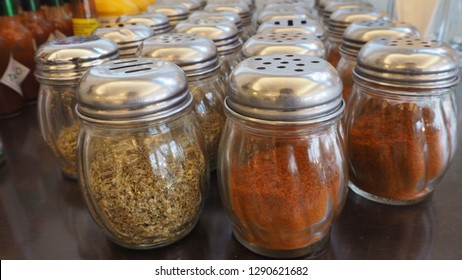 Grind Cayenne pepper and Oregano, flavoring for foods, selective focus