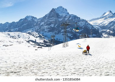 GRINDELWALD BERNE, SWITZERLAND- APRIL 24: Gondola lift  with tower from Grindelwald to First peak cable car station, APRIL 24,2018, Berne, Switzerland. Gondola lift  with tower and  First peak