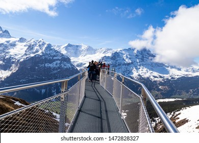 GRINDELWALD BERNE, SWITZERLAND- APRIL 24:Traveller are resting and photograph on sky cliff walk at First peak of Alps mountain Grindelwald Switzerland , APRIL 24,2018, Berne, Switzerland.