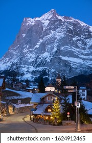 Grindelwald, Switzerland. January 2020. The Wetterhorn mountain in the background with the village of Grindelwald in the foreground. Photographed at dusk during blue hour.