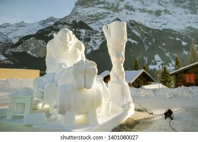 Grindelwald, Switzerland - January 26, 2019: Large statues of two Ogres living bohemian life as portrayed in Snow Festival in Grindelwald, Switzerland during January 2019