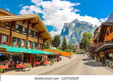 Grindelwald, Switzerland - July, 2013: Dorfstrasse street in Grindelwald with parts of Mattenberg in the background