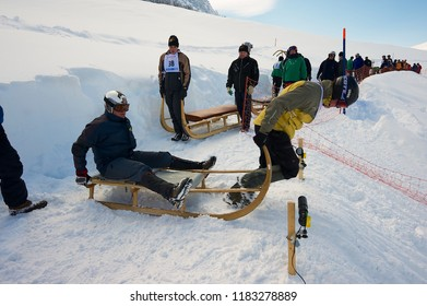 Grindelwald, Switzerland - March 07, 2009: Unidentified men ride traditional horn-sledge at 12-th annual Horn-Sledge Race from Alpiglen to Grund in Grindelwald, Switzerland.