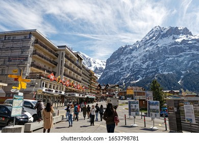 Grindelwald, Switzerland -May 7, 2019: Center of Grindelwald with Hotels and Alps mountains.