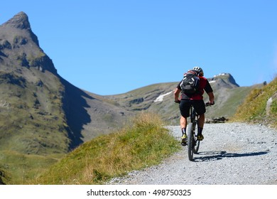 Grindelwald, Switzerland - September 10, 2016: An unidentified biker is enjoying mountain cycling at area of Bachalpsee,  Grindelwald,  Switzerland