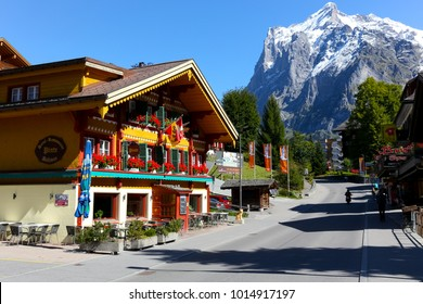 Grindelwald, Switzerland - September 21, 2017: The tourist resort, which is located in the Swiss Alps, impresses with its colorful architecture and huge snow-covered peaks of the mountain ranges.