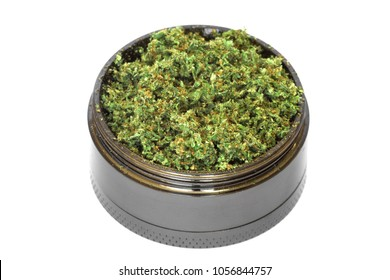 grinder with Crushed buds of marijuana, weed cannabis isolated