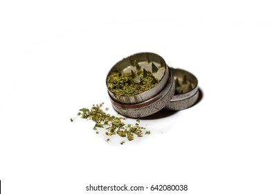 Grinder with weed on white background