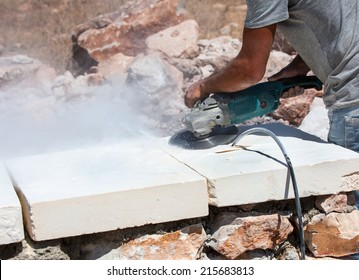 grinder worker cuts a stone the electric tool