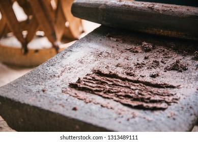 Grinding cocoa beans in a chocolate-making demonstration in Oaxaca, Mexico. The chocolate self-combust in the process.