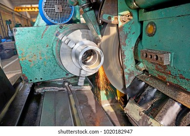 Grinding of parts with emulsion and spark. Intragrinding machine during operation. There grinding inner sleeve hole.